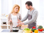 Young attractive couple having an argue while cooking — Stock Photo