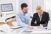 Engineer and architect working at the office — Stock Photo