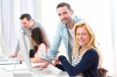 Young attractive people taking a training course — Stock Photo