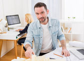 Young attractive architect working at the office  — Stock Photo