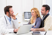 Young attractive couple seeing a doctor  — Stock Photo