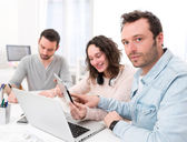 Students working together on a report — Stock Photo