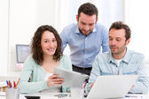 Two interns working together assisted by their course supervisor — Stock Photo