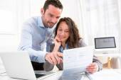 Young attractive couple doing paperwork — Stock Photo