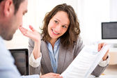 Young attractive woman during job interview — Stock Photo