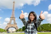 Young attractive asian tourist enjoying her Paris trip — Stock Photo