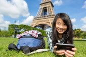 Young attractive asian tourist smartphone tablet in Paris — Stock Photo