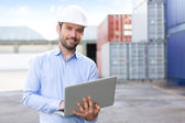 Young Attractive engineer using laptop on the dock — Stock Photo