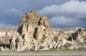Rock outcrop with the ancient Christian dwellings in the vicinity of Goreme. Turkey — Stock Photo