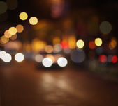 Abstract city lights blur blinking background. Soft focus. — ストック写真