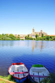 Boats at Tormes river, in front of the Cathedral of Salamanca  — Stock Photo