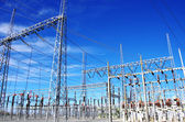 High-voltage substation on blue sky — Stock Photo