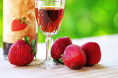 A Bottle and glass of  Raspberry Liqueur — Stock Photo