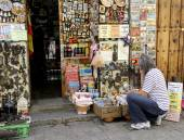 Woman shopping for souvenirs in Segovia Spain — Stock Photo