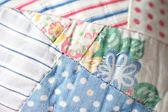 Closeup of antique quilt — Stock Photo
