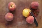 Ripe summer peaches, one peeled — Stock Photo