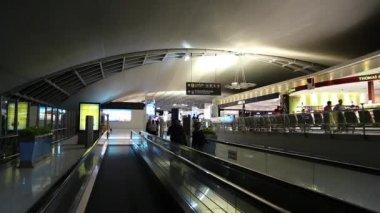 People on travelator inside Bangkok international airport in Thailand — Stock Video