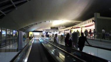 People on travelator inside international airport — Stock Video