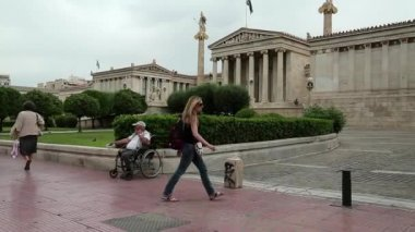 Destitute disabled person on invalid chair — Stock Video