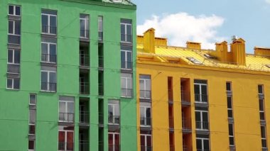 Buildings with green and yellow facades — Stok video