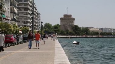 White tower and people on the waterfront — Stock Video