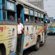Постер, плакат: People on the move come in the colorful bus in Kolkata