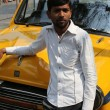 Indian taxi driver posing in front of his cab in Kolkata — Stock Photo #52758113