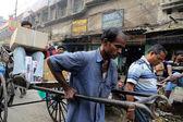 Rickshaw driver working, Kolkata, India — Stock Photo