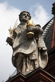 St. Totnan on the Facade of Neumunster Collegiate Church in Wurzburg — Stock Photo