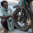 Mechanic repair the motorbike in Baidyapur, India. — Stock Photo #52791701