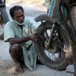Mechanic repair the motorbike in Baidyapur, India. — Stock Photo #52791727