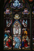 Baptism of the Christ, Stained glass in Votiv Kirche in Vienna — Stock Photo