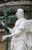 Angel statue in front of Karlskirche church in Vienna — Stock Photo