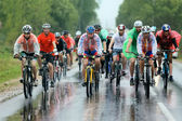 A group of cyclist racer racing  in the rain — Stock Photo