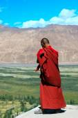 Buddhist monk against mountains in the Himalayas — Stock Photo