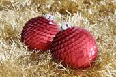 Two red Christmas baubles on golden tinsel — Stock Photo