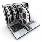 Laptop and film — Stock Photo #53024185