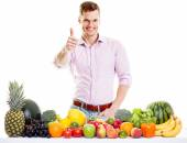 Fit man with healthy food - vegetables and fruits isolated on wh — Stock Photo