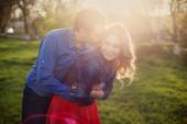 Loving couple hugging in the park at sunset — Stock Photo
