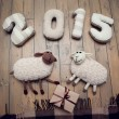 Happy New year 2015 and toy sheep handmade wooden background — Stock Photo #59142923