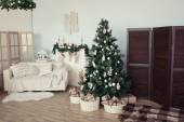 Christmas tree with presents underneath in living room — Stock Photo