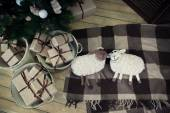 Christmas tree with presents underneath and toys sheep — Стоковое фото