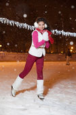 Beautiful girl on a skating rink in the winter evening — Stock Photo
