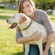 Beautiful woman with her dog. Labrador retriever — Stock Photo #77135553