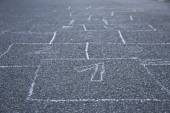 Black and white hopscotch one through nine at a playground — Stock Photo