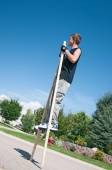 Teenage boy on stilts — Stock Photo