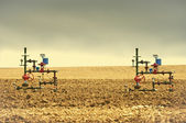 Two Wellheads From Gas Wells — Photo