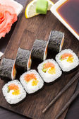 Sushi rolls with salmon and vegetables — Stock Photo