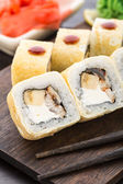 Sushi rolls with smoked eel and banana — Stock Photo