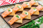 Potato pancakes with salmon — Stock Photo